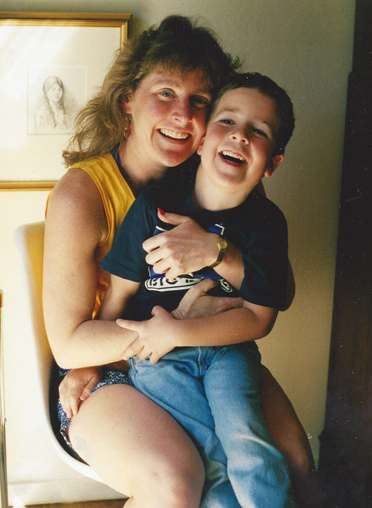 an image of Margo holding her son Jimmy on her lap when he was a small boy around 5 years old.