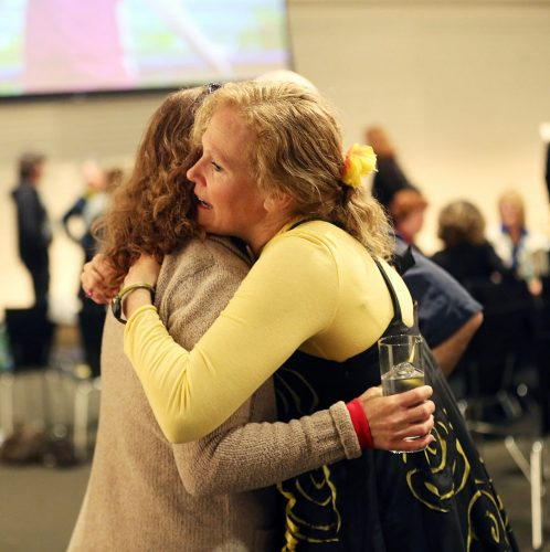 an image of two middle aged women hugging and comforting each other