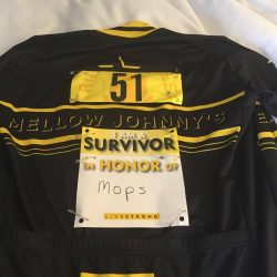 The author's LIVESTRONG cycling jersey with a card on the back saying Survivor - In honor of Mops