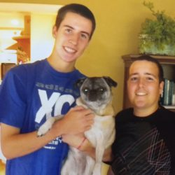 Willie on the left wearing a blue shirt and holding Susie, his pug. Jimmy is on the right wearing a black shirt.