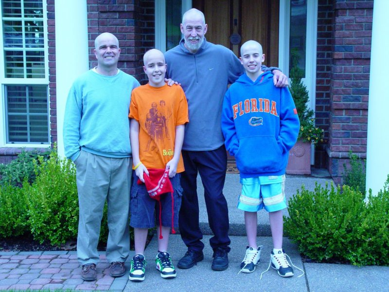 Dan in light blue pullover, Jimmy in orange shirt, Robin in light navy pullover and Willie in Florida Gators sweatshirt, all bald