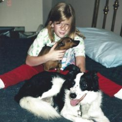 Jerry's daughter with Spinner, a brown min-pin and Domino, a black and white border collie