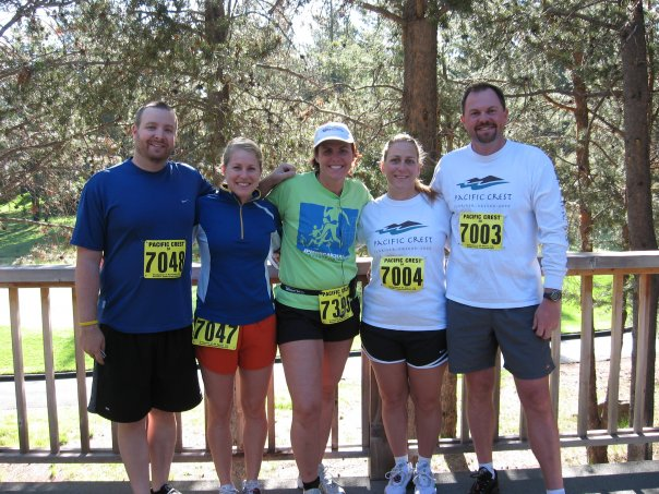 Stephanie Morfitt and her siblings. They all have race numbers on. Steph is second from the left. Her sister, Sissi is in the center.