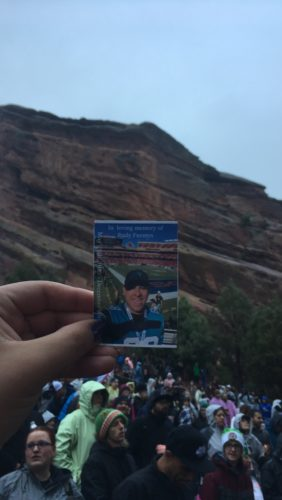 Rudy's photo in front of a mountain with a group of people below