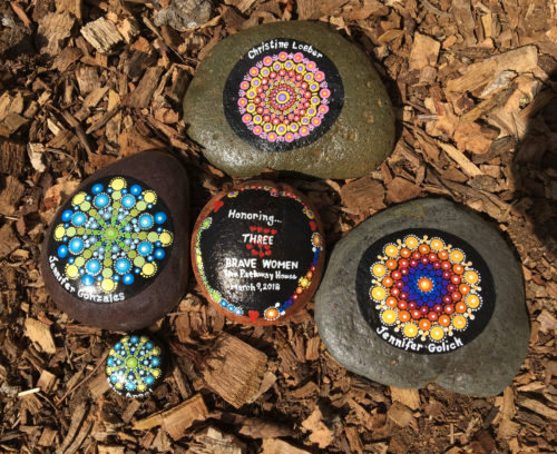 Painted rocks in memory of the three women killed at Pathway House on March 9, 2018