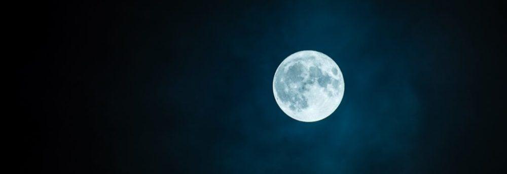 White full moon against a dark night sky