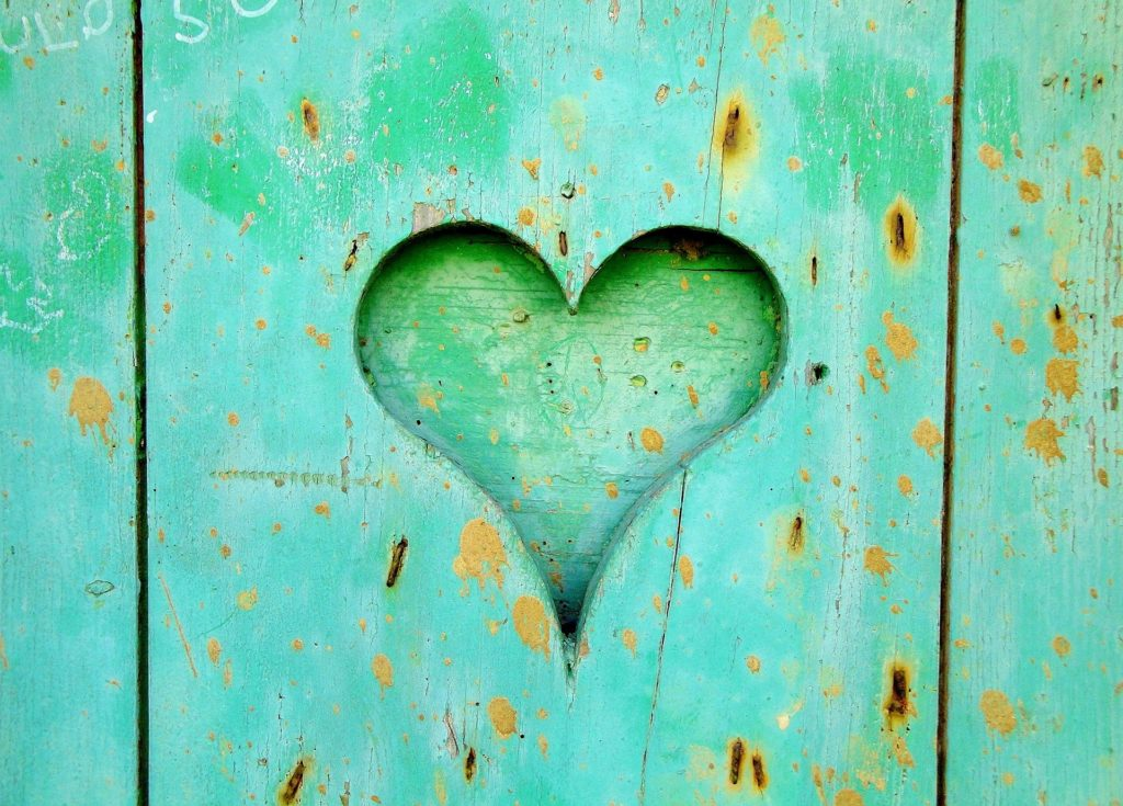 Heart cut out in wood painted light green
