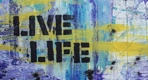 The words LIVE LIFE are shown against a backdrop of yellow, light blue and purple random stripes of paint