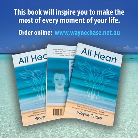 Wayne's book All Heart. There are three copies fanned out -- the first and third are facing up; the middle copy is of the back cover.