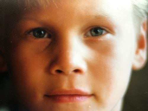 Scott, age five. It's a close up of his face where only his eyes, nose and mouth are visible in the photo.