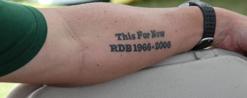 "Chris Brewer's tattoo which says ""This For Now RDB 1968-2006"""